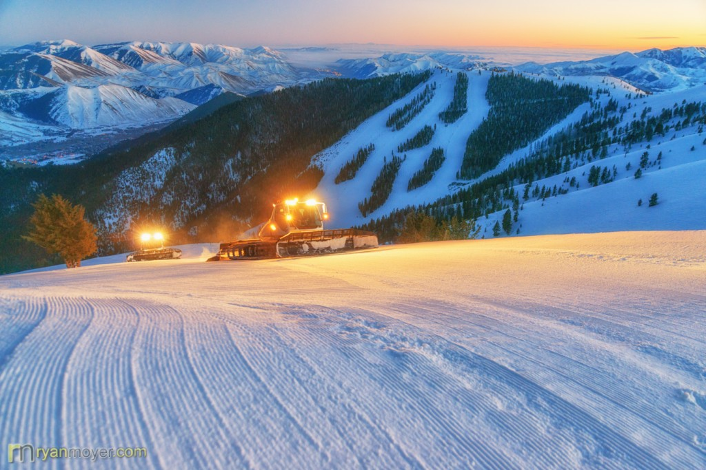 Sun Valley's famous grooming crew goes to work as the sun sets on Bald Mountain.